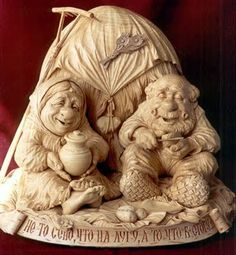 Weefolk couple wood sculpture