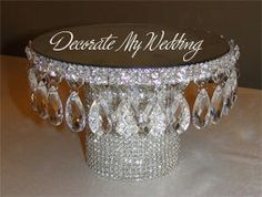 This as a Cake Stand  or to hold a centerpiece.. can on bottom  styrofoam on top  mirror & bling..