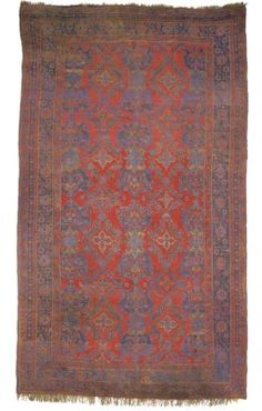 USHAK CARPET  WEST ANATOLIA, LATE 19TH CENTURY  Overall very good condition  21ft.5in. x 12ft.5in. (651cm. x 379cm.)