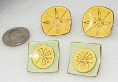 Lot of 2 pairs of clip on earrings. These are made of porcelain. 1 earring is marked with a sticker that reads  Pat. Pending Milvern Co. Inc.  . No others have the stickers but are clearly the same m