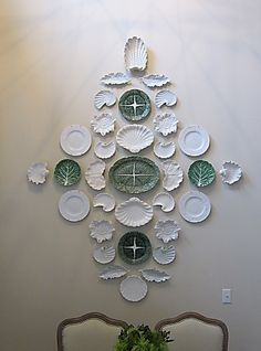 Terry Wilder plate wall with white shell plates mixed with green leaf majolica.