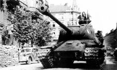 A column of tanks of the Czechoslovak army corps on the streets of Prague. The case was part of the Ukrainian front of the red Army. Near the tank car Opel Kadett