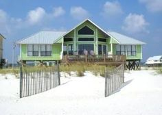 Gulf Shores, AL: This Gulf-front 4-bedroom, plus loft, 4-bath Gulf Shores beach home is nestled among the white sandy beaches of Gulf Shores, Alabama.     The center of ...