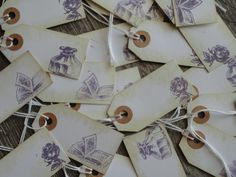 Vintage book theme Tags for Favors, Thank you, Gift tags- lot of 50   Rustic, Boho, Library, Romance, escort cards, place cards, wedding - I like the book one - add blue ribbon and use for escort cards?