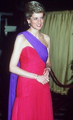 Princess Diana in a fuchsia and purple silk chiffon dress by Catherine Walker. She worn the dress in Thailand in February 1988. The dress has gone on display in Kensington Palace.