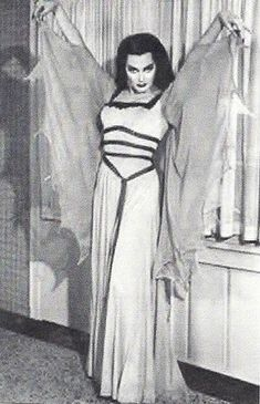 Lily Munster spreading her wings. Haha! I preferred The Munsters over The Addams Family any day.