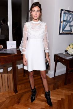 Alexa Chung wore a fail-safe Alexa formula to attend a Vogue party in New York: a pretty dress toughened up with punky boots. We love.