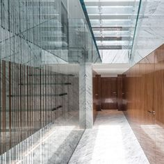 British architect Luke Lowings worked with American sculptor James Carpenter to create this patterned glass staircase. Standing alone, it rises the full height of the two-storey space leading up through a skylight to a roof terrace overlooking Hong Kong's bay.