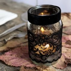 A chic candle holder for Halloween with black lace and velvet.
