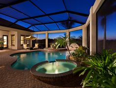 Pool With Planters And Screened Lanai With Plenty Of