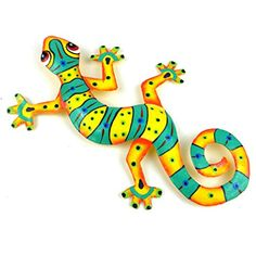 This gecko is handmade in Haiti from recycled oil drums. Each has a small hook to hang the piece, and is painted with a bright colorful design inspired by the local Haitian culture. From head to tail, the gecko is 8 inches long. Hanging Wall Art, Metal Wall Art, Lizard Dragon, Aluminum Can Crafts, Painted Rocks, Hand Painted, Soda Can Crafts, Clay Art Projects, Mexico Art