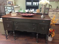 A striking buffet, finished in a custom mix of Graphite and French Linen Chalk Paint® decorative paint by Annie Sloan and 3 layers of Dark Soft Wax | By Vintage Hip Décor http://vintagehipdecor.com