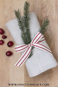 Hostess Gift Ideas: Homemade bread wrapped in a linen towel and ribbon from onsuttonplace.com