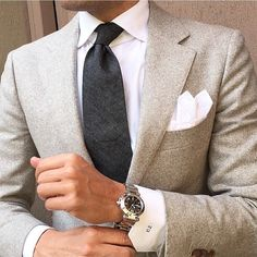 Marry a beige wool blazer with a white oxford shirt for a sharp classy look. Shop this look on Lookastic: https://lookastic.com/men/looks/blazer-dress-shirt-tie/21215 — White Dress Shirt — Charcoal Tie — Beige Wool Blazer — White Pocket Square — Silver Watch