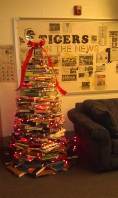 From a Pinterest idea, a nudge from a fellow teacher, and a lot of book pulling, look what we created in the Herscher High School Library today (with our Student Librarians). Will be adding more colored lights on Monday.