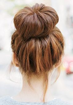 Pin your hair up into a sleek ballerina bun. Shake it out at the end of the day for sexy, tousled waves that will take you straight to happy hour. // #Hair