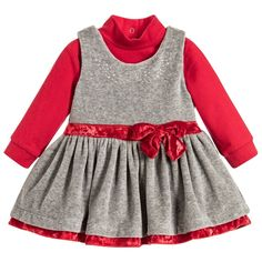 This cute dress set by Minibanda is just right for baby girls who need an outfit that could be worn at a party but is also comfortable. The sparkly grey velour dress has red trims and diamantés with popper fasteners down the back. It comes with a red polo-neck top that has poppers between the legs, ideal for speedy nappy changes and to keep the top in place.