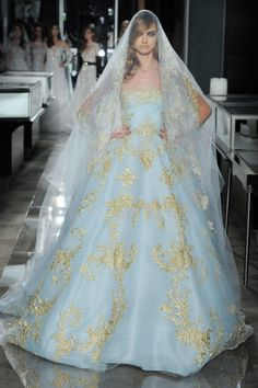 An incredible blue and gold Reem Acra wedding dress: http://www.stylemepretty.com/2017/05/01/most-beautiful-spring-2018-wedding-dresses/ Photography: Maria Valentino