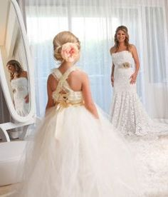 wedding photo ideas - Bride looking at the flower girl