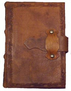 Leather-belted journal. Drool.