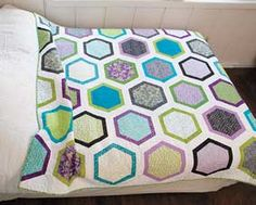 Spice up any room in your house with this daring and exquisite Reverie Quilt Kit from Connecting Threads