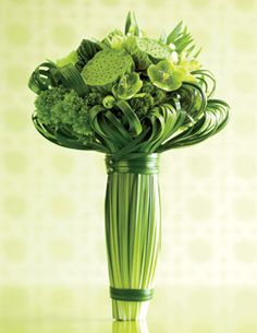 Brides.com: 48 Creative Wedding Flower Ideas. Modern green wedding bouquet with hellebore and fritillaria. When working with a verdant color palette, give your florist the go-ahead to experiment with different kinds of greenery. Tightly tied with lily grass, this sculptural bouquet combines flowers (hellebore, fritillaria) with textural touches like seed pods and foliage (lotus pods, bear grass).   Floral design by Ovando.
