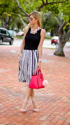Black and white striped midi skirt, topshop open back black body suit, baublebar phlox collar floral necklace, quay australia silver necjkace, michele deco 20 mm watch, schutz margo nude and white sandals, baublebar byob bracelets, pink henri bendel tote and wavy blonde hair, and pink blush pouf keychain. amanda tur, a fancy affair blog, miami fashion blogger