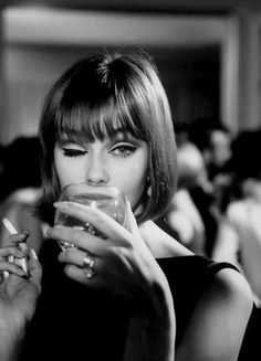 This. The hair. The makeup. The elegantly classic dress. The jewellery. All of it... except the cigarette.