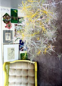 God give me the patience to one day do this.  It's a straw chandelier.  I've seen them and their really cool, pretty easy, but you gotta be patient.
