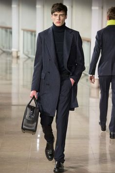 "Hermès - Fall 2015 Menswear - Look 11 of 44 Reminds me of the early Beatles' garb in some respects. Sleek, minimal, unfussy, grab and go, but manly and ageless. Admirable. A gentilhomme dresses for himself, and he is cool. Mr. 50 Shades of Midlife Crisis dresses for women, and I know what that means. It means he dresses to ""get"" women, who are just notches in his belt. That's uncharming. That's not manly at all."