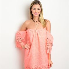 NWT Neon Coral Lace Dress This off the shoulder neon coral and lace dress is absolutely stunning and super girly. NWT! Runs a size smaller. Accepting reasonable offers! No trades! Bundle and get 30% off! Dresses