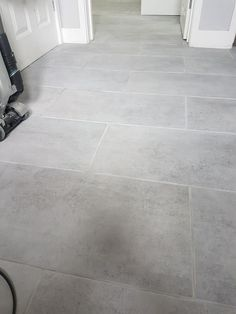 Redo grout white with commercial sealant White Hallway, Tiled Hallway, Tile Stairs, Flooring For Stairs, Grey Kitchen Floor, Kitchen Redo, Kitchen Flooring, Stone Tile Flooring, Grey Flooring