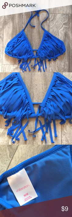 Blue bathing suit top ☀️ Triangle suit top. Size Medium. Padded. Ties behind back and neck. Cute fringe detail! Worn only once or twice. Bundle with any other item in my closet and save 20%! Xhilaration Swim Bikinis