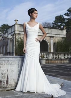 Sincerity wedding dress style 3736 Lace cap sleeves accent the chiffon cowl neckline on this draped  modified mermaid gown. The back neckline has a lace criss-cross and the  style has a semi chapel length train.