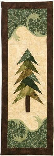 Misty Pine uses a paper pieced tree with quick fuse applique for the decorative elements.