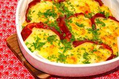 Her er den bedste opskrift på ovnbagt kartoffelmos, der bages med parmaskinke. Mosen er med smør og pyntes inden servering med persille.