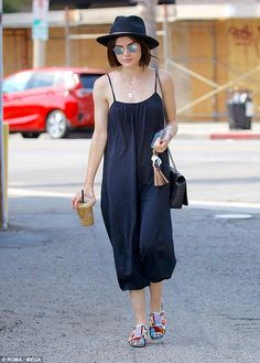 Caffeine fix: Lucy Hale, 28, grabbed a coffee in Los Angeles on Thursday while showing off her style credentials in a chic navy jumpsuit and colourful mules