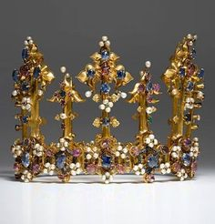 The oldest surviving crown of an English queen, 1370-80. Gold, enamel, sapphires, rubies, emeralds, diamonds, pearls. Recorded in England in a list of jewels and plate drawn up in 1399.