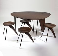 Isamu Noguchi (1904-1988 American) :: An Isamu Noguchi (1904 - 1988 American) 'Rudder' dining table model #IN-20 and stools model #IN-22 to be offered in the February 5, 2013 auction