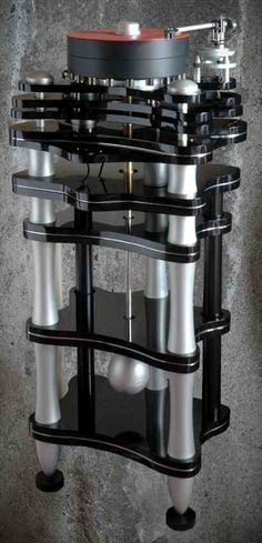 ITALIAN STATEMENT   High mass 165Kilos turntable made of massive floor standing structure with 270mm long platter spindle and fully adj...