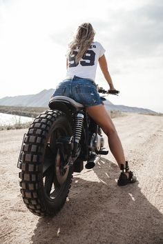 Picture of Sexy girl biker sits on her custom built cafe racer motorcycle in the desert. Back view stock photo, images and stock photography. Cafe Racer Girl, Cafe Racer Build, Scooter Motorcycle, Cafe Racer Motorcycle, Motorcycle Style, Motorbike Girl, Motorcycle Girls, Motorcycle Helmets, Lady Biker