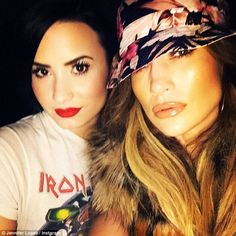 Cross generation friends: Former Disney star Demi Lovato pictured here with Jennifer Lopez at the gig