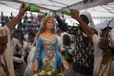 Devotees salute Yemanja, Goddess of the Sea, during a ceremony as part of traditional New Year's celebrations on the sands of Copacabana beach in 2010 in Rio de Janeiro, Brazil. ...