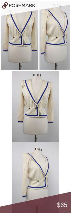 "Vtg 80s St. John Santana Knit Cream Cardigan Vtg 80s St. John Santana Knit Cream with Blue Trim Sweater Cardigan.   80% Wool 20% Nylon Santana.  Measurements (flat / un-stretched): Tagged Size: M Bust: 36"" Sleeve: 22"" Length (shoulder to hemline): 20"" St. John Sweaters Cardigans"