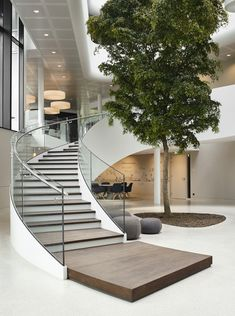 Image 21 of 31 from gallery of New Highly-energy Efficient Office for Vreugdenhil / Maas Architecten. Courtesy of Maas Architecten Staircase Railing Design, Home Stairs Design, Curved Staircase, Interior Stairs, Modern Staircase, Dream Home Design, Modern House Design, Home Interior Design, Railing Ideas