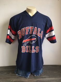Vintage BUFFALO BILLS Jersey Tshirt 80's Football NFL Shirt Logo 7 UsA Made X-Large Excellent! by sweetVTGtshirt on Etsy Db Football, Vintage Football, Buffalo Bills Shirt, Nfl Shirts, Overalls, Graphics, Logo, Tees, Mens Tops