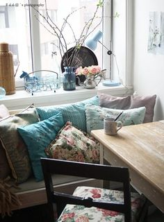 kitchen nook... cluster of pillows in the corner.