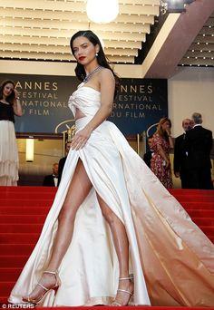 Walk this way: She slipped into a pair of metallic heels as she strutted her stuff up the iconic stairs