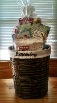 Baby shower DIY laundry gift  basket, light reading books, laundry oxispray, diapers and wipes.