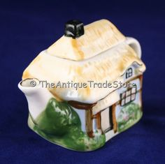 Resultados de la Búsqueda de imágenes de Google de http://www.theantiquetrade.co.uk/ekmps/shops/theartdecostore/images/vintage-porcelain-cottage-teapot-miniature-2193-p.jpg